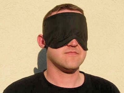 Covering the eyes of with or as if with a bandage each person had