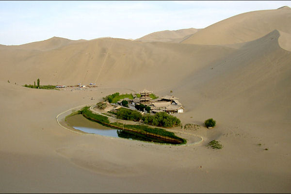 Crescent Moon Pool in Xinjiang  Oasis Landform Desert