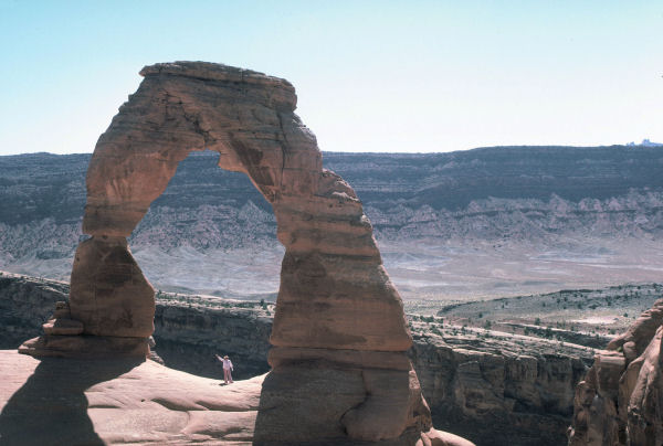 Bernice Noll waves to you from the center of the Delicate Arch from